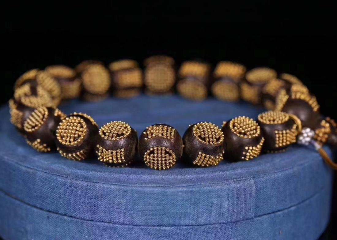 A CHENXIANG WOOD BEADS STRING BRACELET - 2