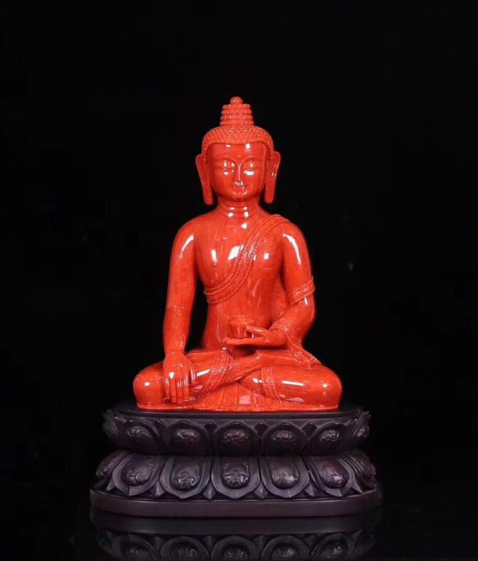 A RED CORAL CARVED PHARMACIST BUDDHA