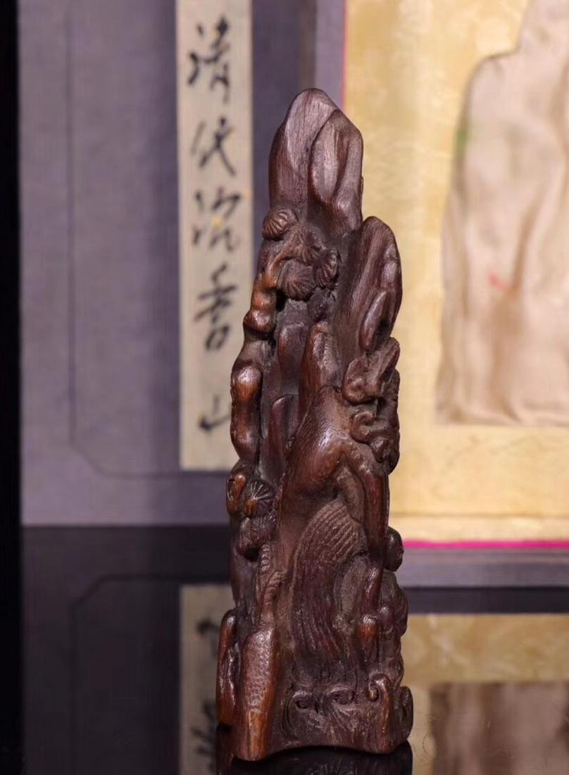 A CHENXIANG WOOD CARVED PENDANT - 6