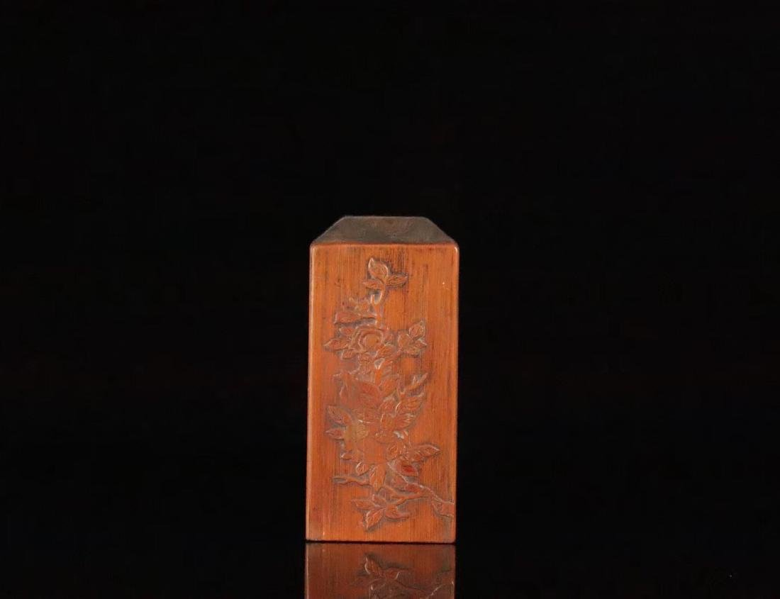 A RED WOOD AND BAMBOO CARVED STUDY SEAL