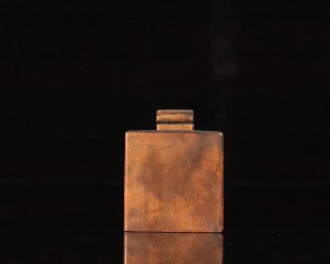 A HUANGYANG WOOD SQUARE SHAPED SEAL