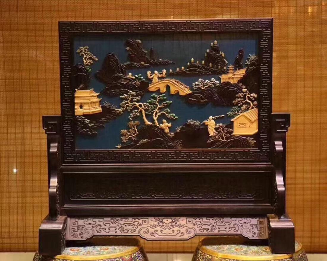 A ZITAN AND LACQUER LANDSCAPE PATTERN SCREEN