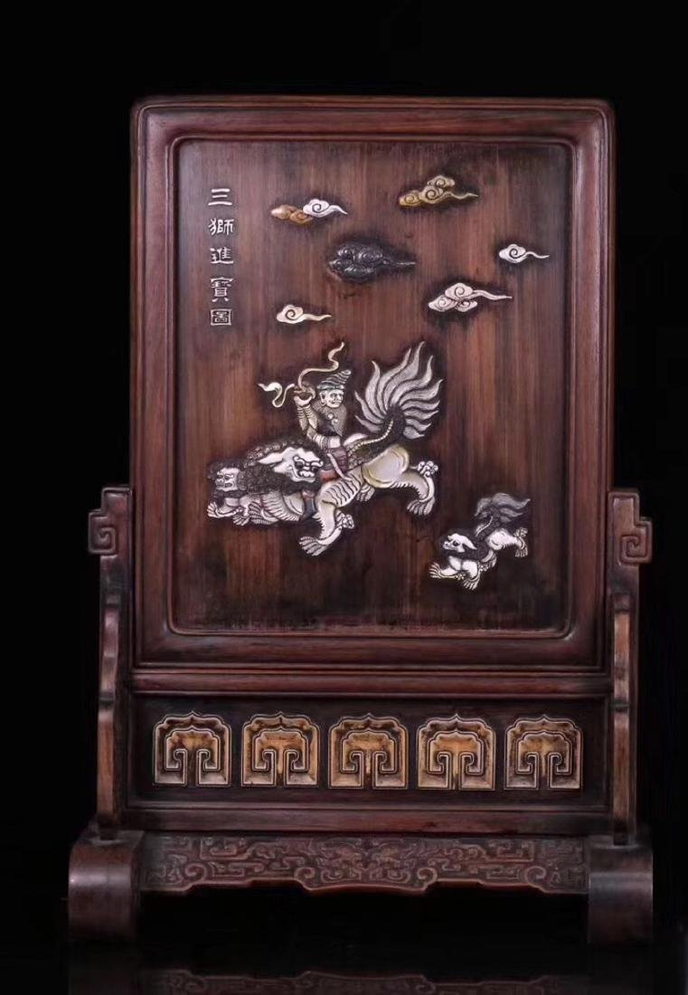 A RED SUANZHI WOOD WITH SHELL DECORATED SCREEN