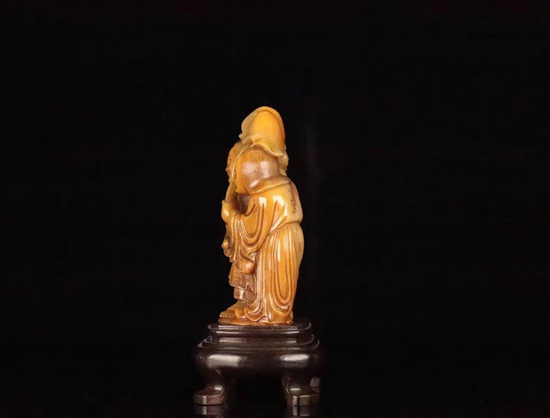 A TIANHUANG STONE CARVED FIGUE PENDANT - 2