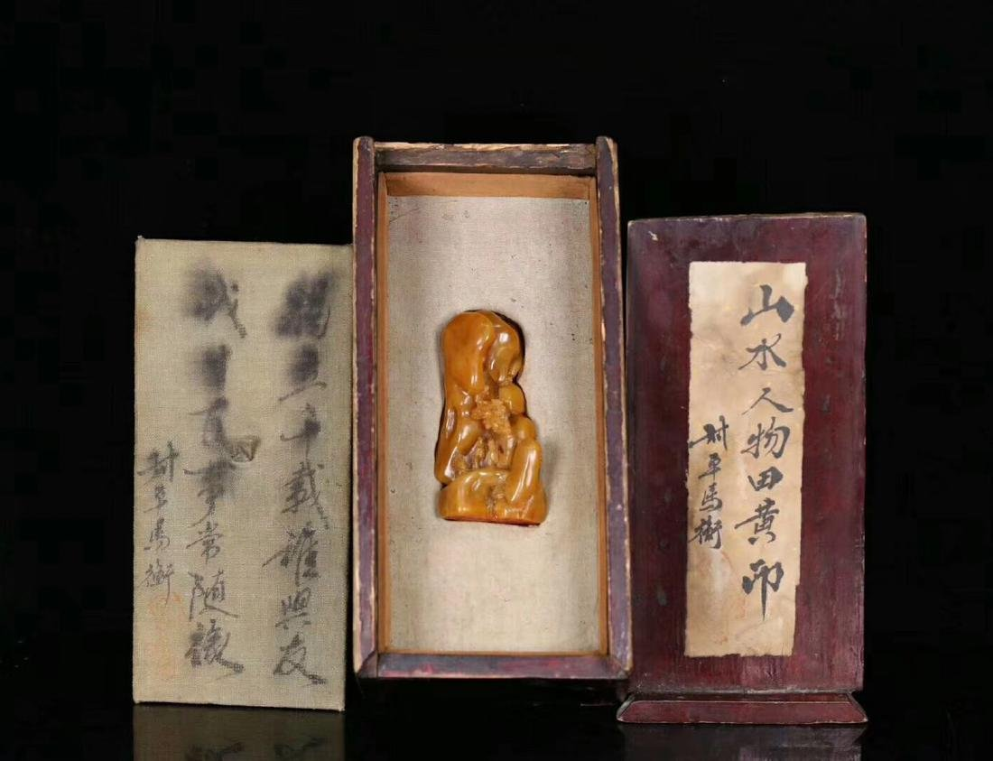 A TIANHUANG STONE CARVED STORY SHAPED SEAL