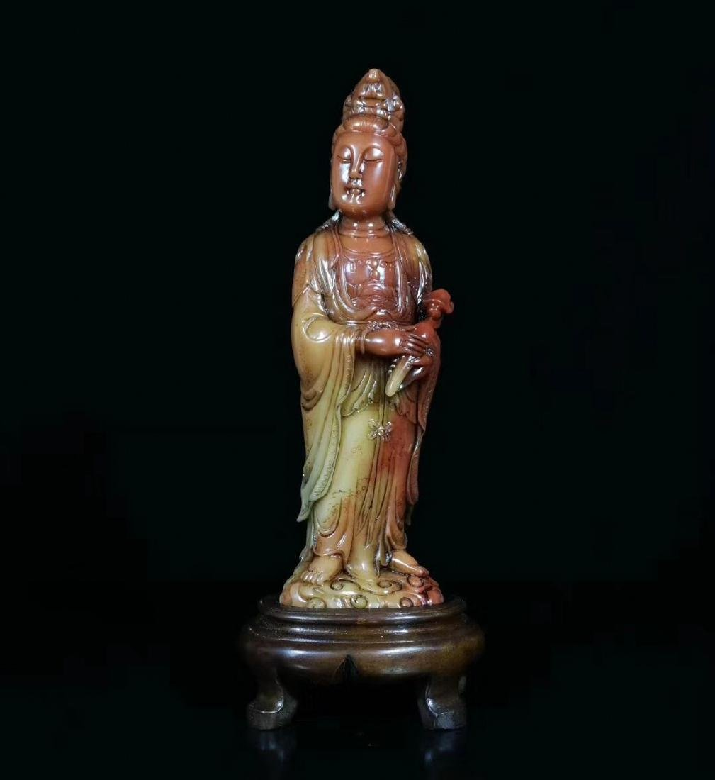 A SOAPSTONE CARVED GUANYIN FIGURE
