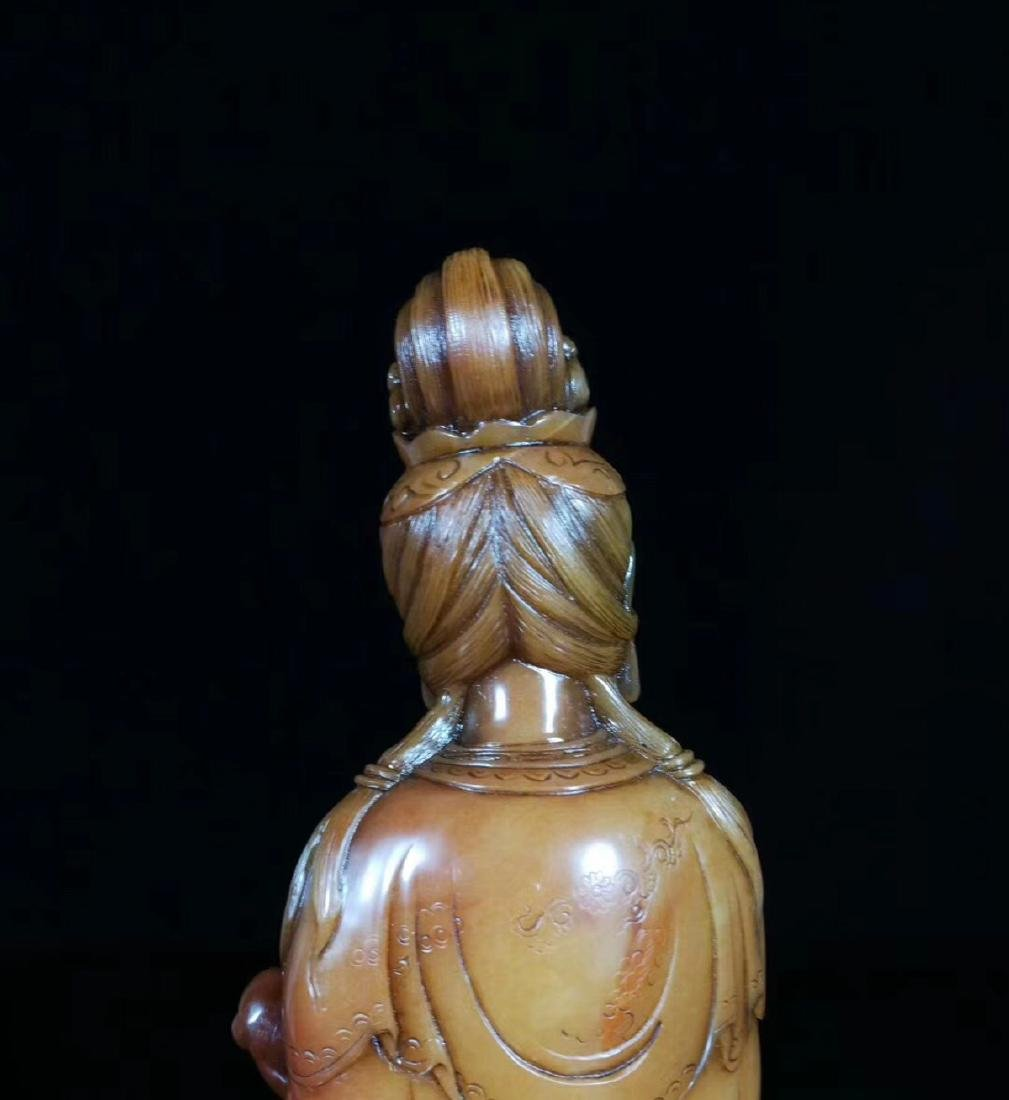 A SOAPSTONE CARVED GUANYIN FIGURE - 8
