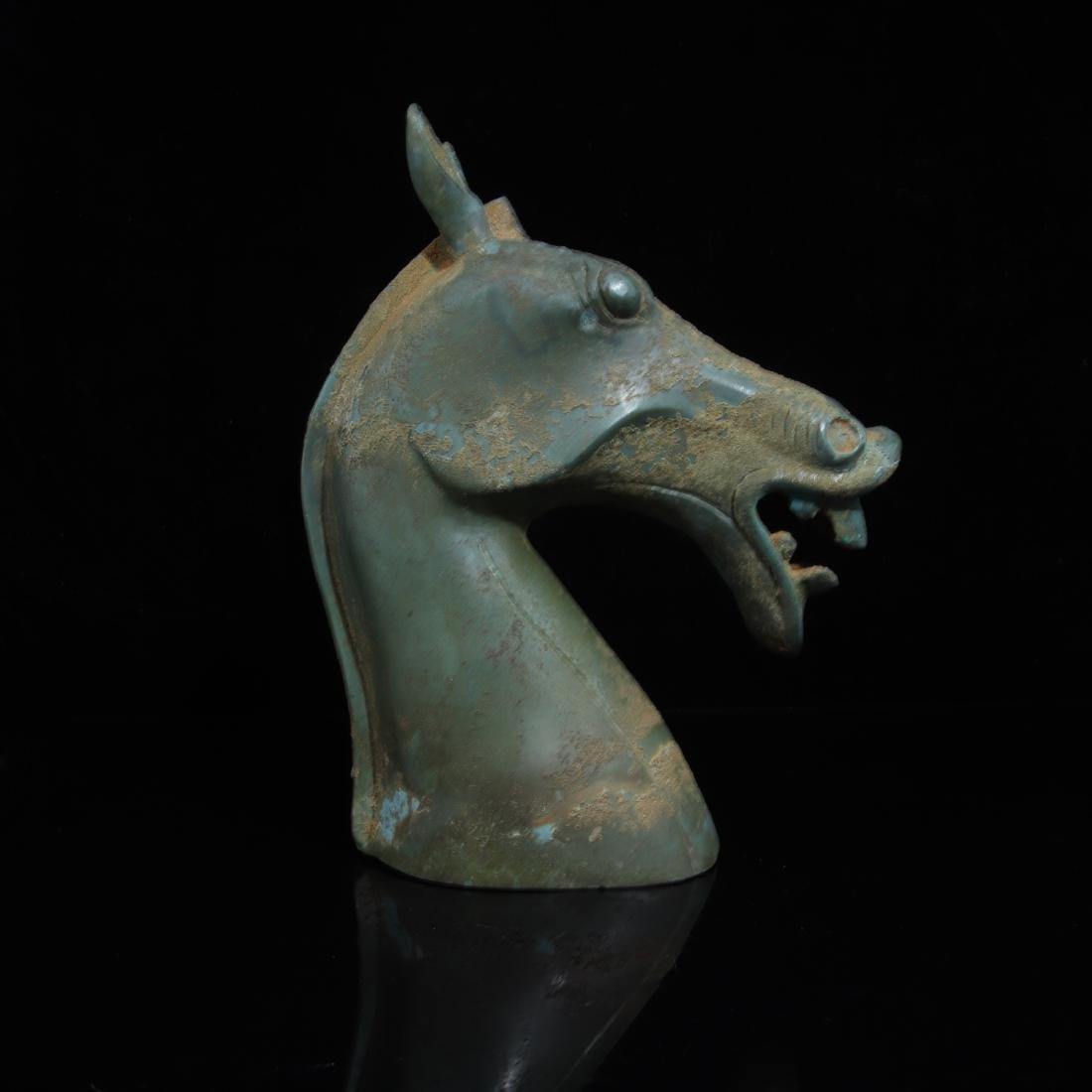 A COPPER HORSE HEAD SHAPED FIGURE - 3