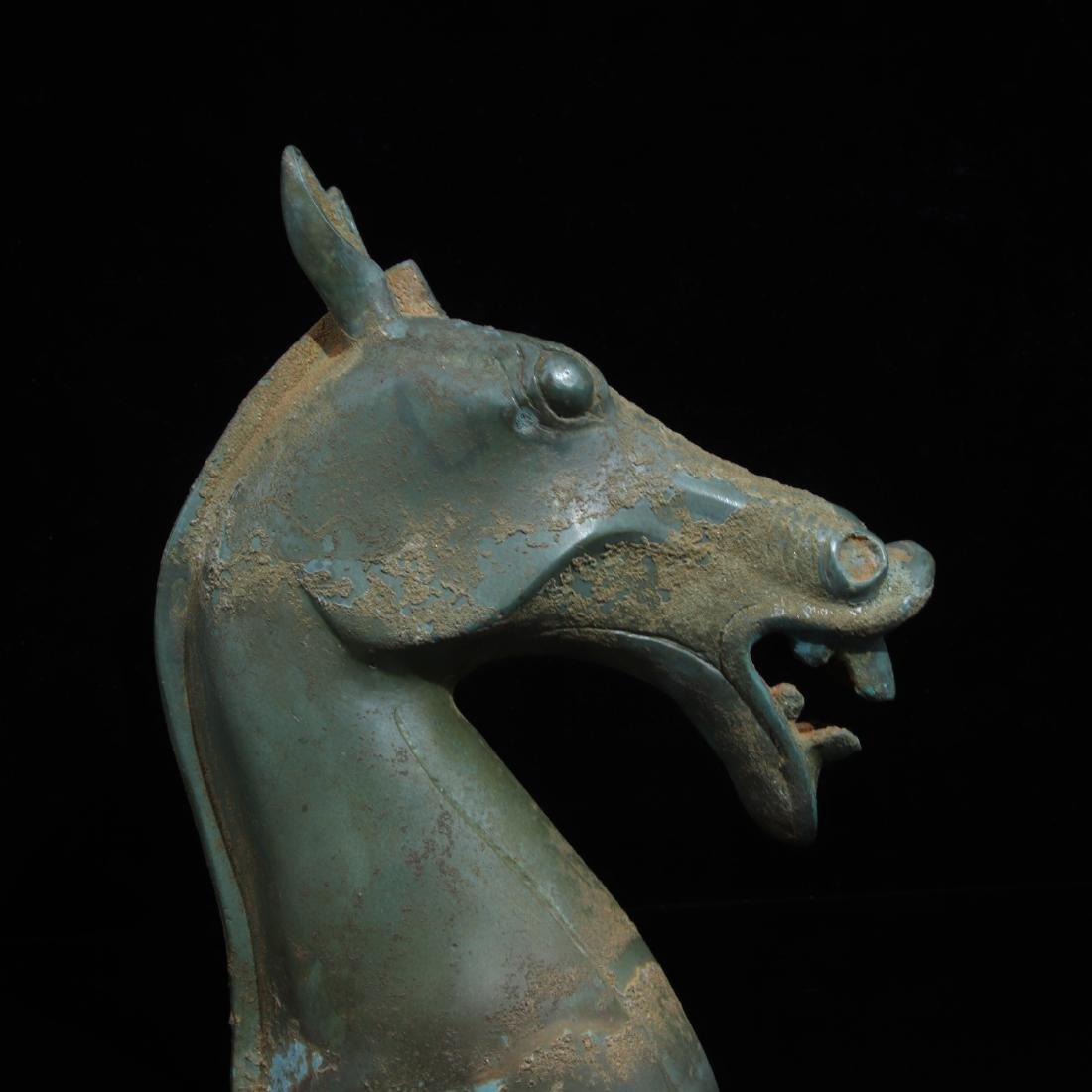 A COPPER HORSE HEAD SHAPED FIGURE - 5