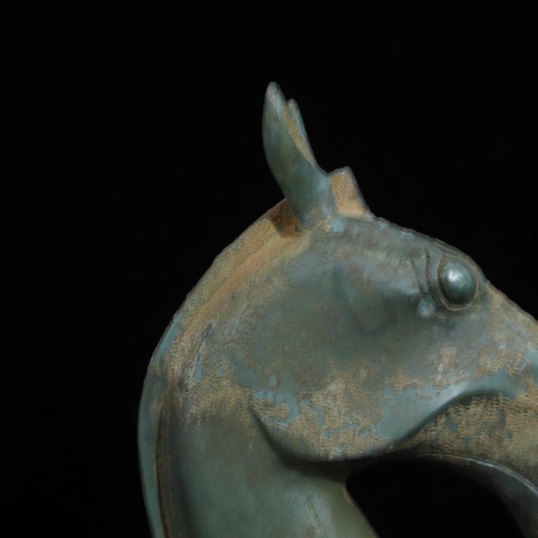 A COPPER HORSE HEAD SHAPED FIGURE - 6