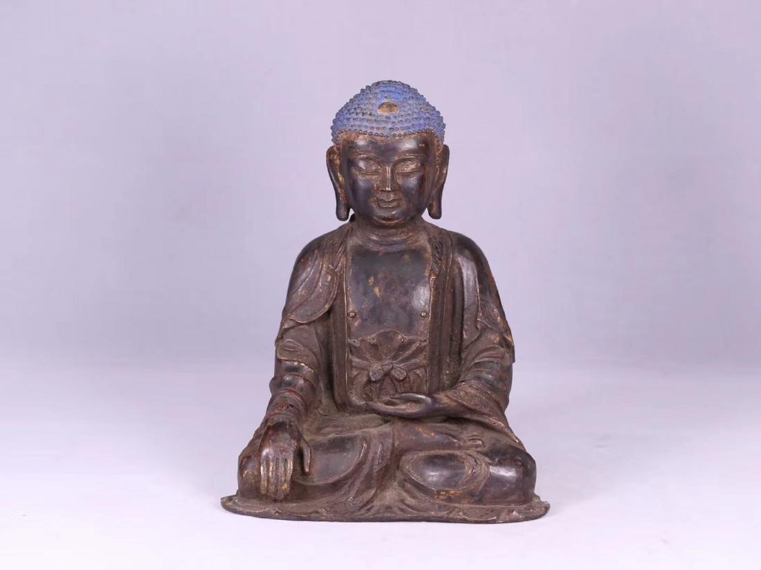 A GILT BRONZE CARVED BUDDHA