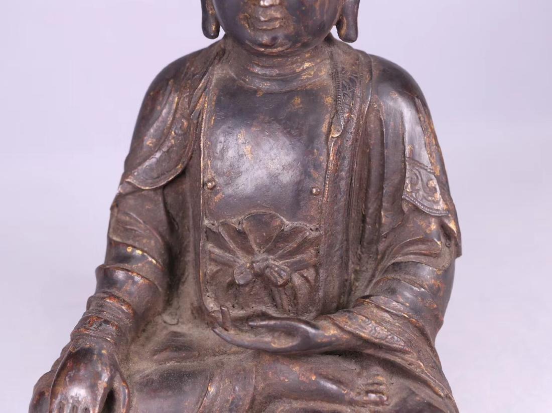 A GILT BRONZE CARVED BUDDHA - 9