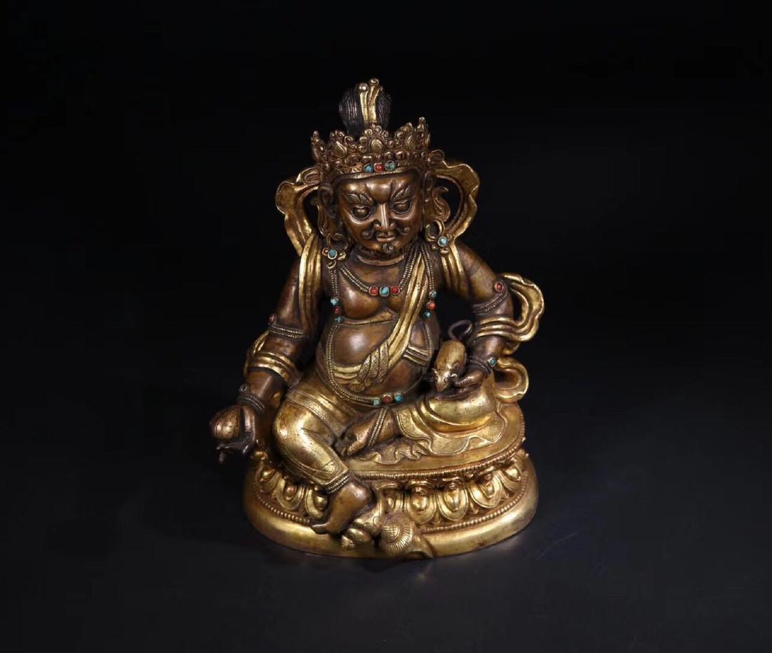 A GILT COPPER WEALTH BUDDHA