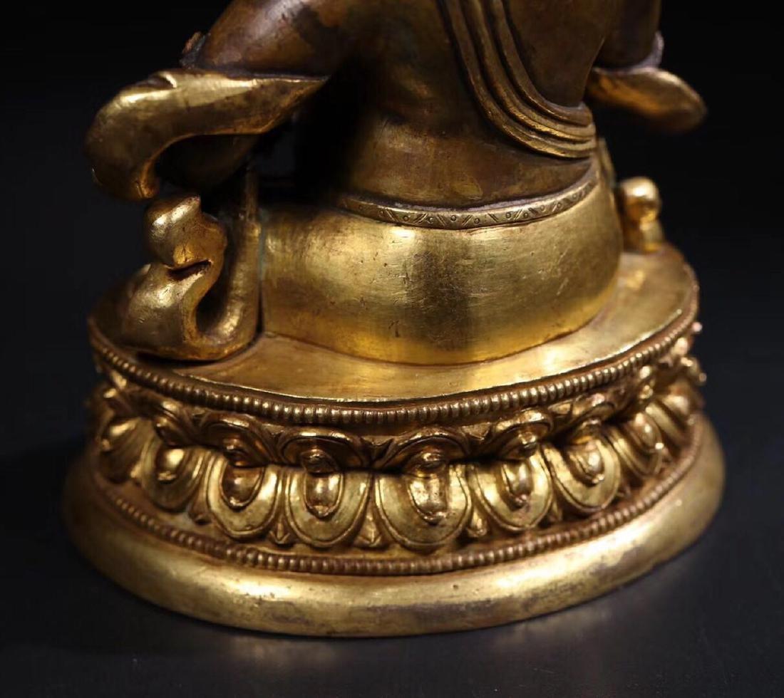 A GILT COPPER WEALTH BUDDHA - 2