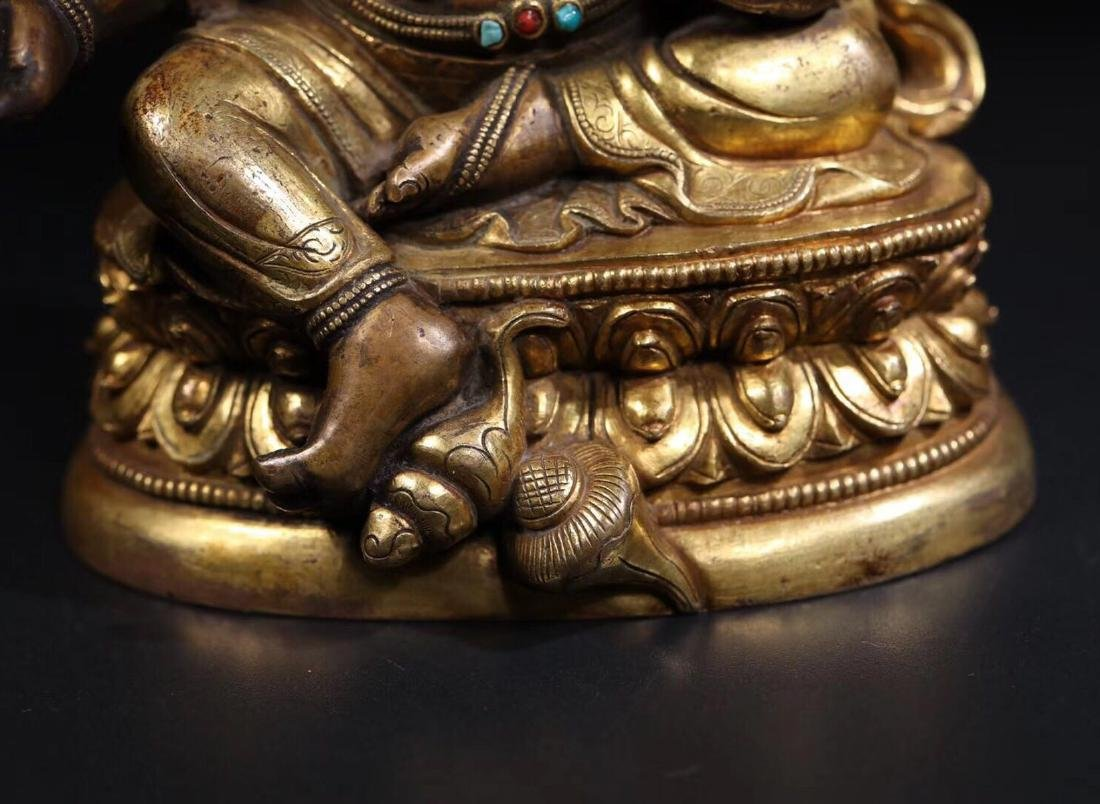 A GILT COPPER WEALTH BUDDHA - 5