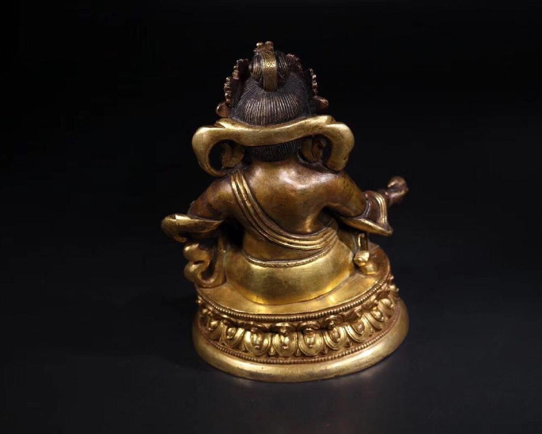 A GILT COPPER WEALTH BUDDHA - 7
