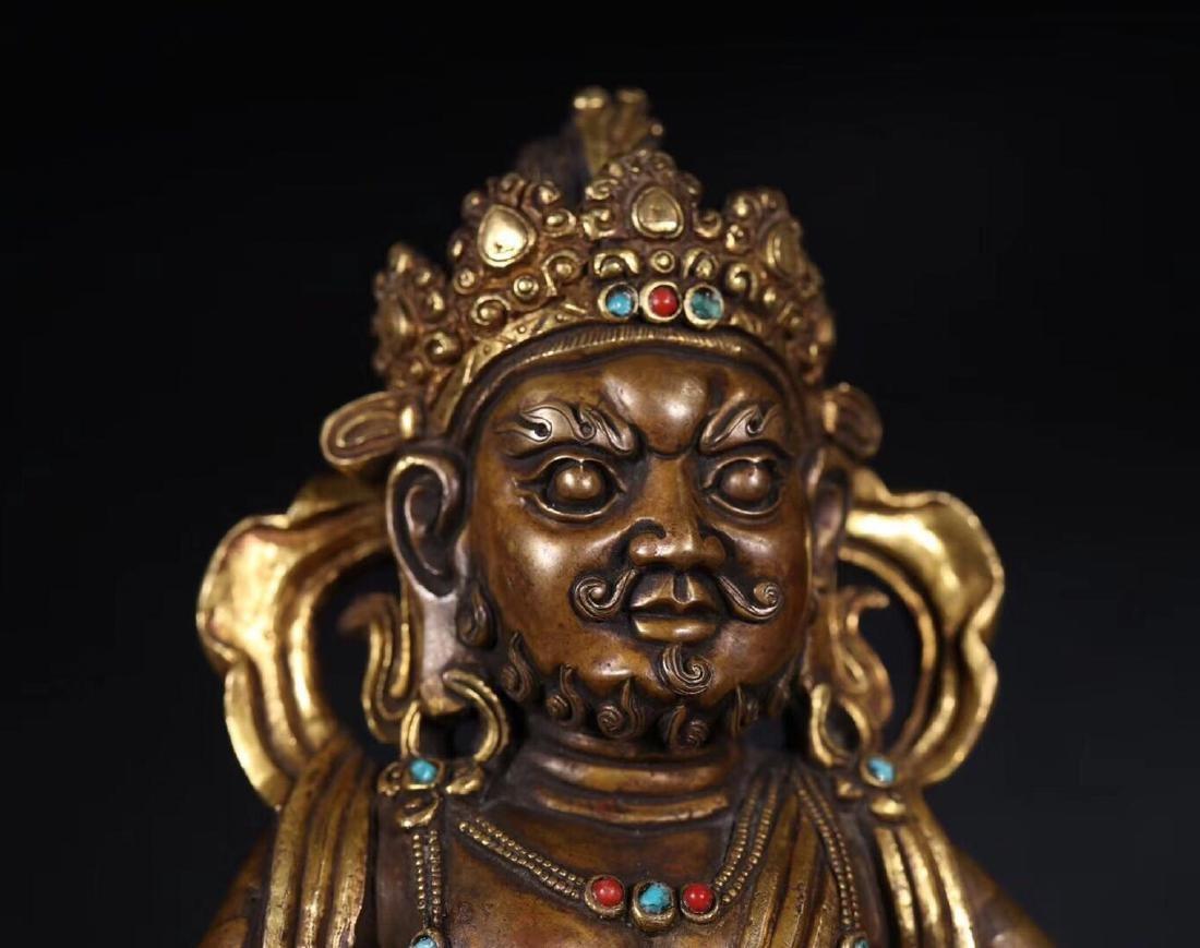 A GILT COPPER WEALTH BUDDHA - 8
