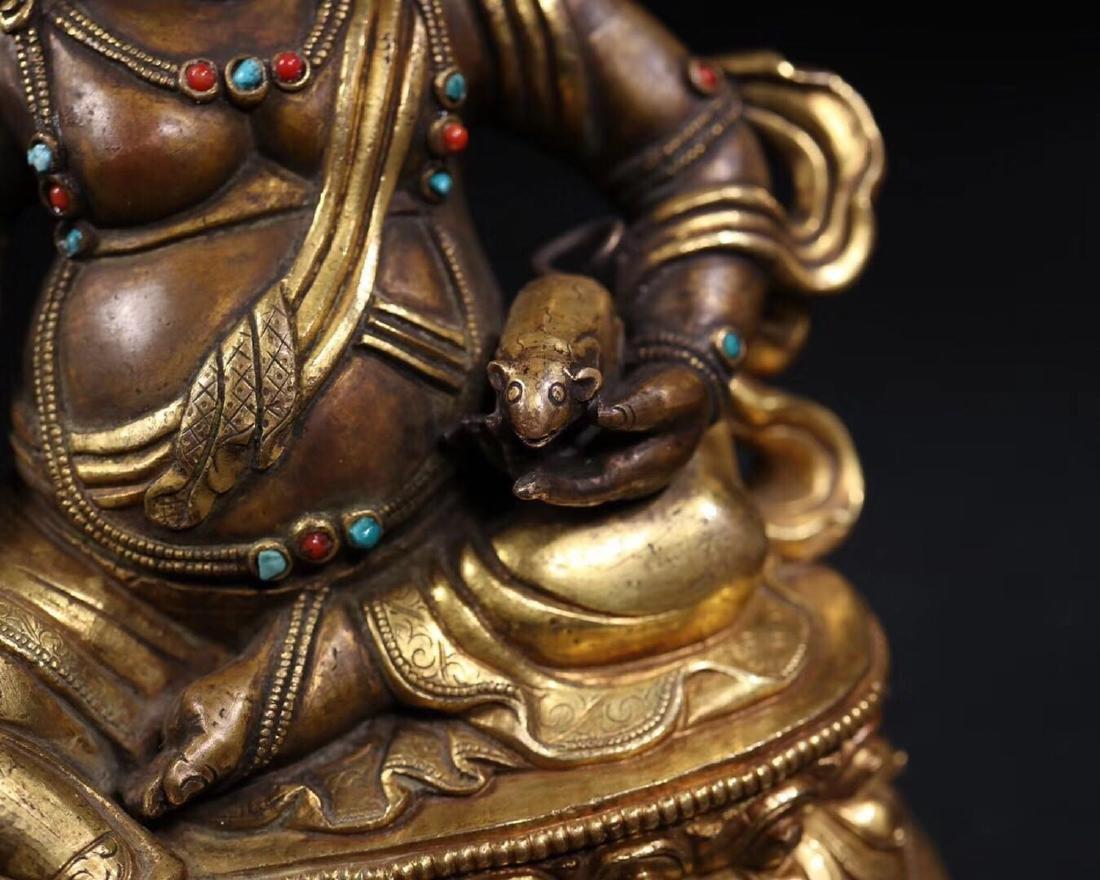 A GILT COPPER WEALTH BUDDHA - 9