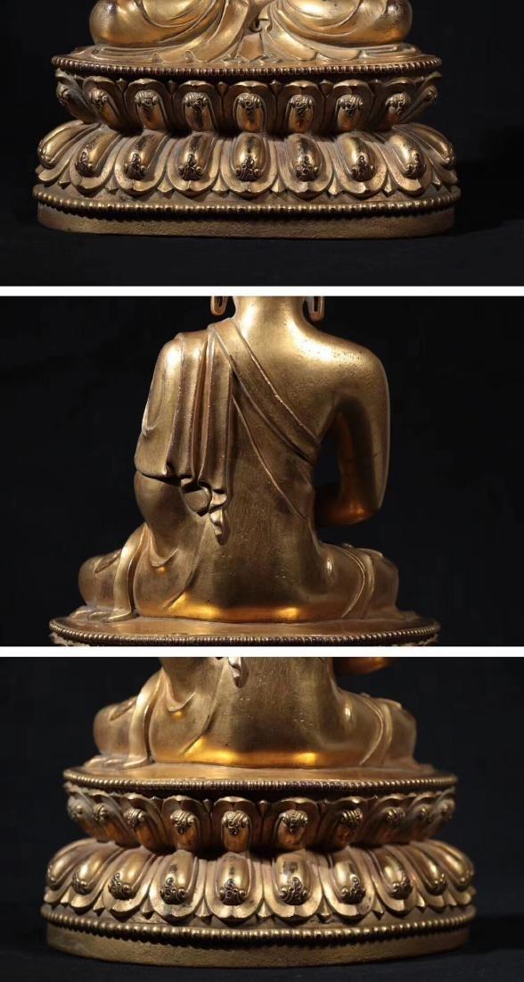 A GILT BRONZE MOLDED SHAKYAMUNI BUDDHA - 10