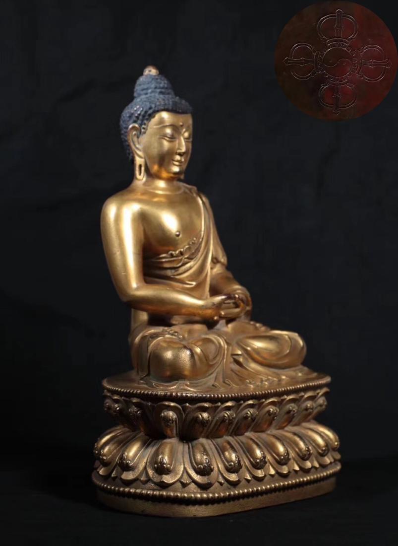 A GILT BRONZE MOLDED SHAKYAMUNI BUDDHA