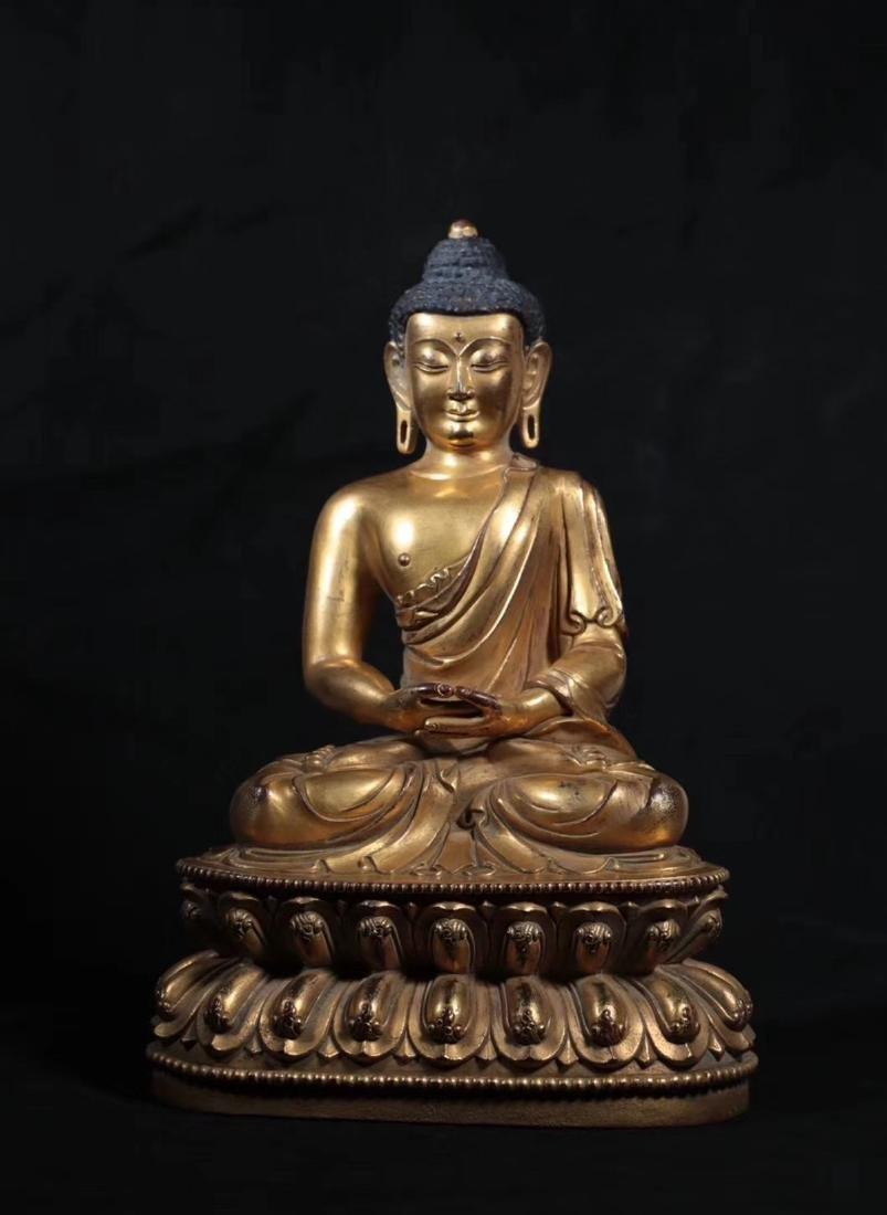 A GILT BRONZE MOLDED SHAKYAMUNI BUDDHA - 2