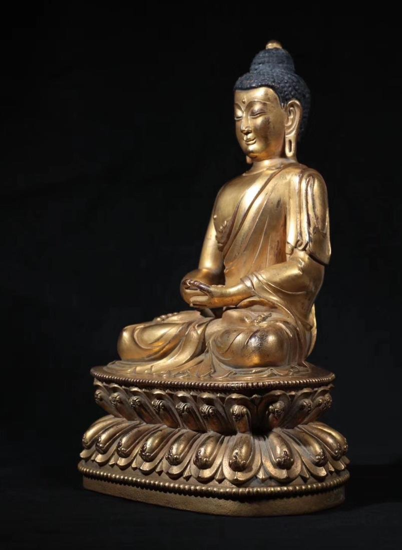 A GILT BRONZE MOLDED SHAKYAMUNI BUDDHA - 4