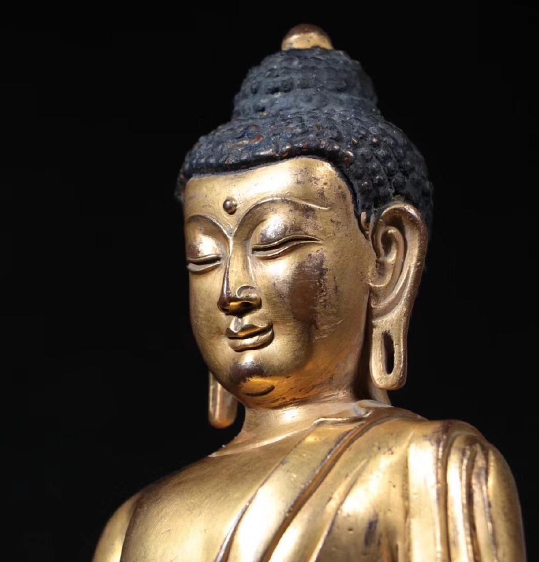 A GILT BRONZE MOLDED SHAKYAMUNI BUDDHA - 6