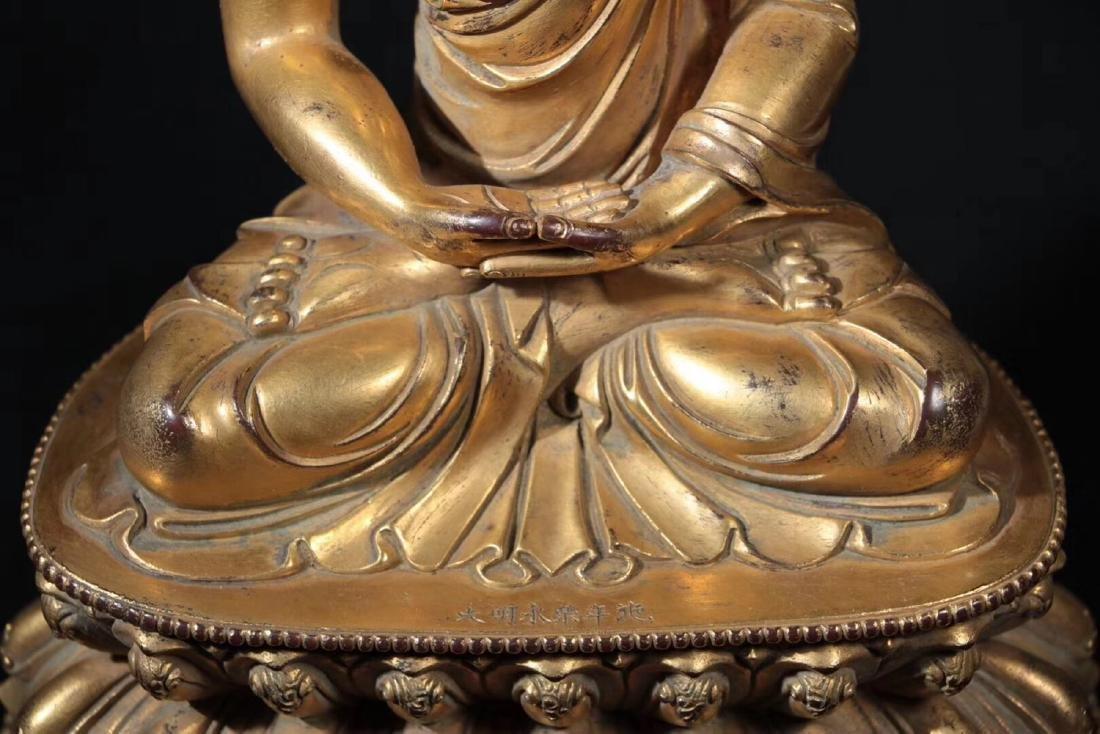 A GILT BRONZE MOLDED SHAKYAMUNI BUDDHA - 8