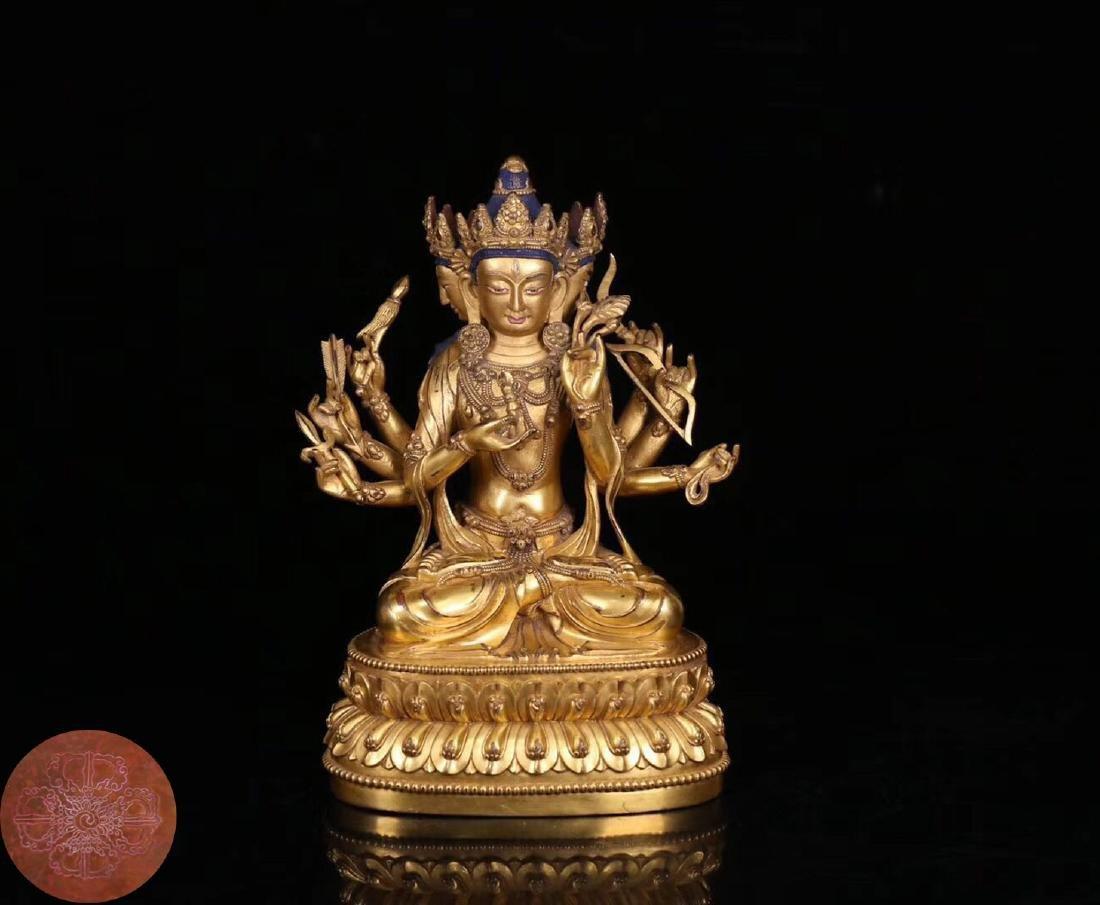 A COPPER GILT SANMIANBABI GUANYIN BUDDHA