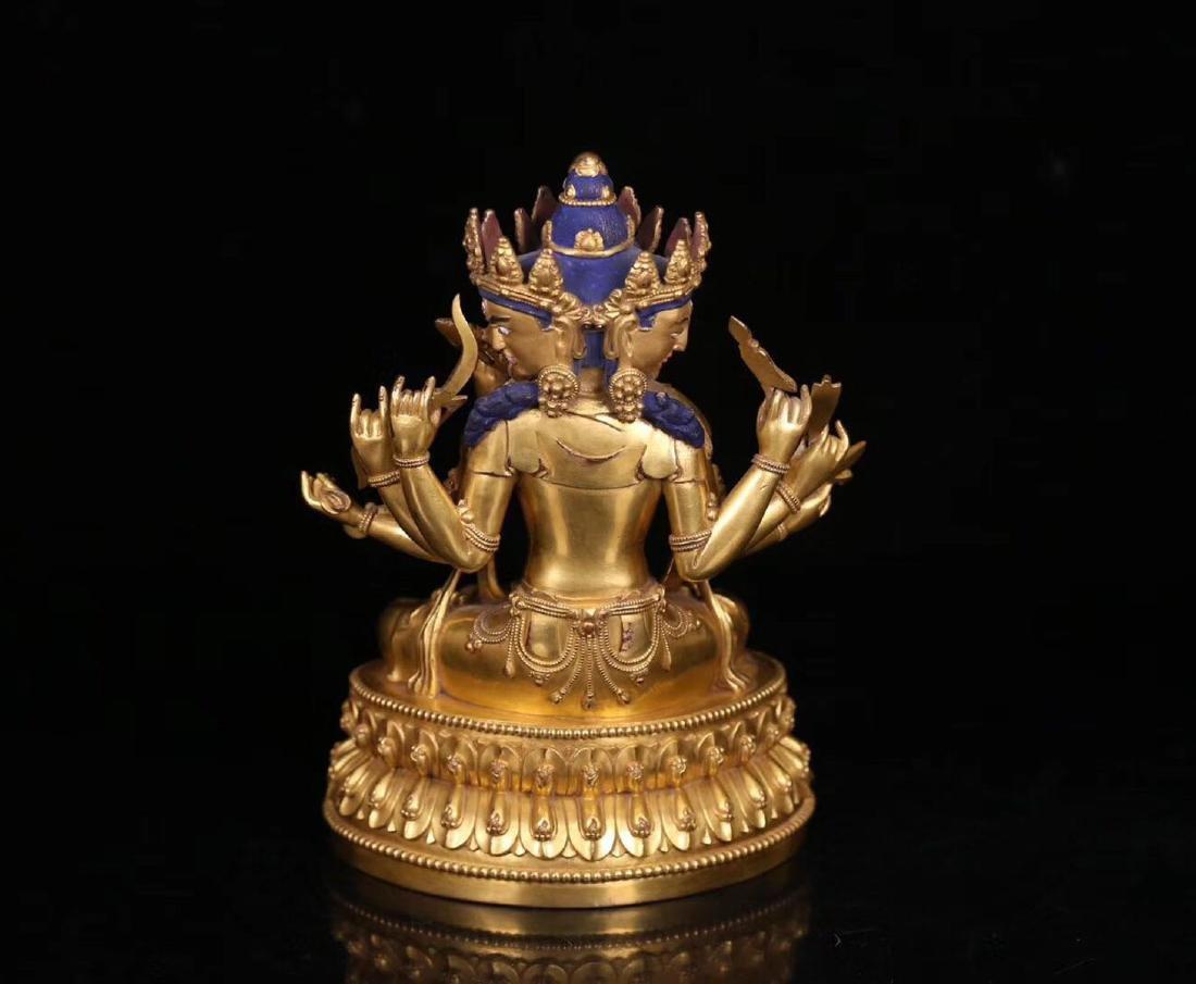 A COPPER GILT SANMIANBABI GUANYIN BUDDHA - 4