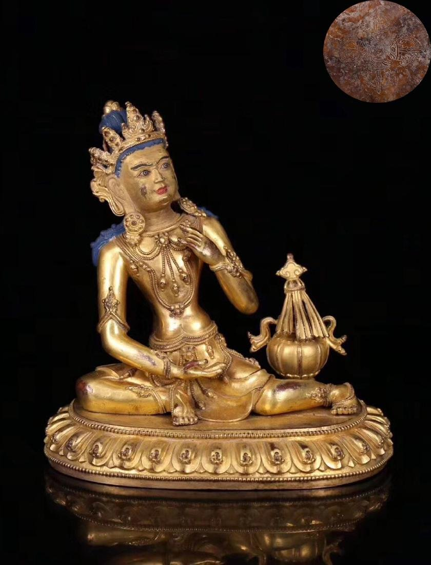 A GILT BRONZE MOLDED BUDDHA STATUE WITH MARK