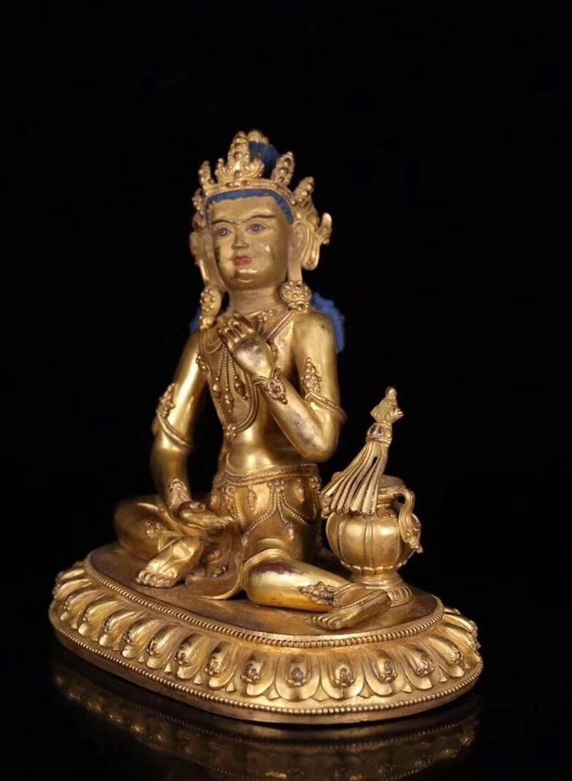 A GILT BRONZE MOLDED BUDDHA STATUE WITH MARK - 2