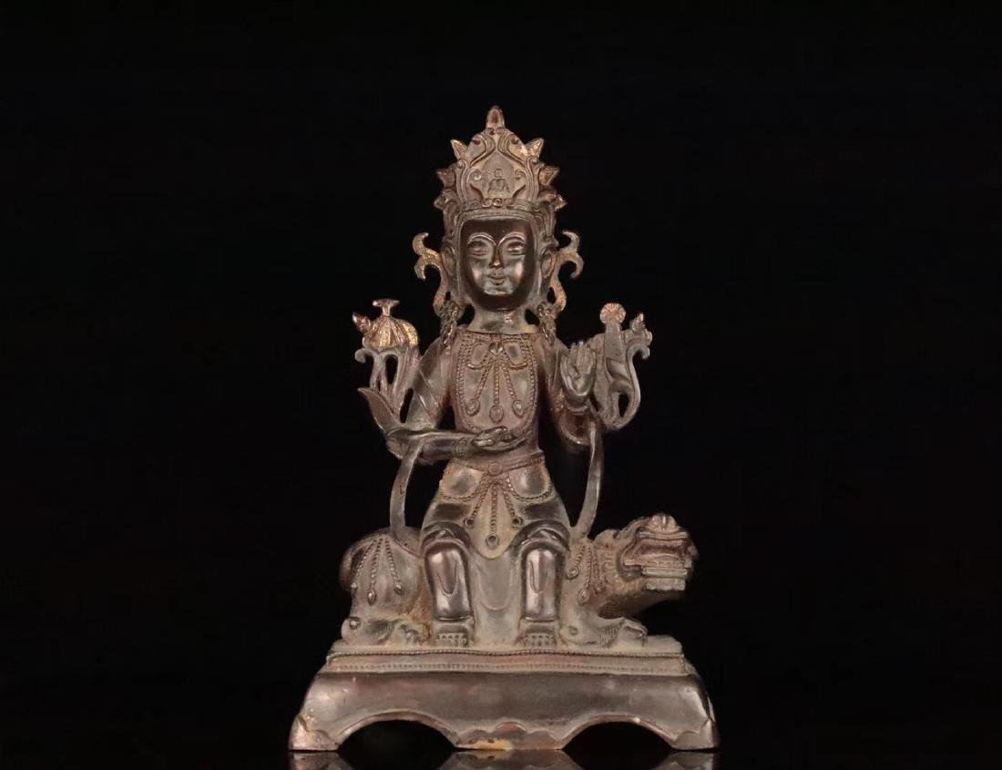 A TIBETAN GILT BRONZE BUDDHAN ORNAMENT
