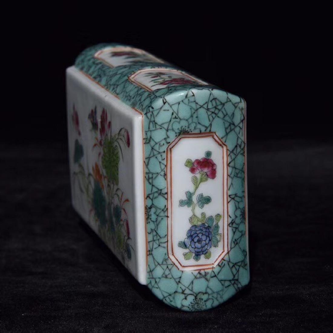 A FAMILLE-ROSE FLORAL PAPER WEIGHT - 5