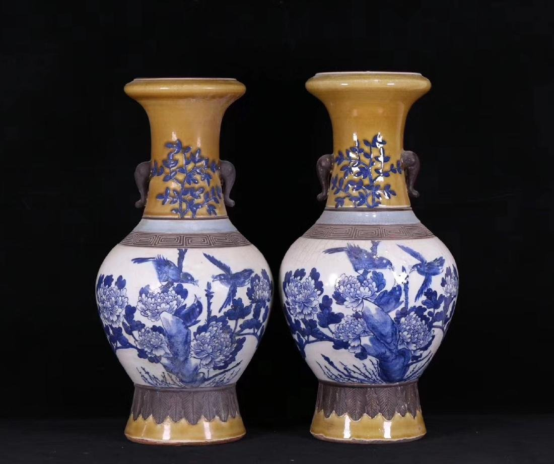 PAIR BLUE AND WHITE FLORAL PATTERN VASES