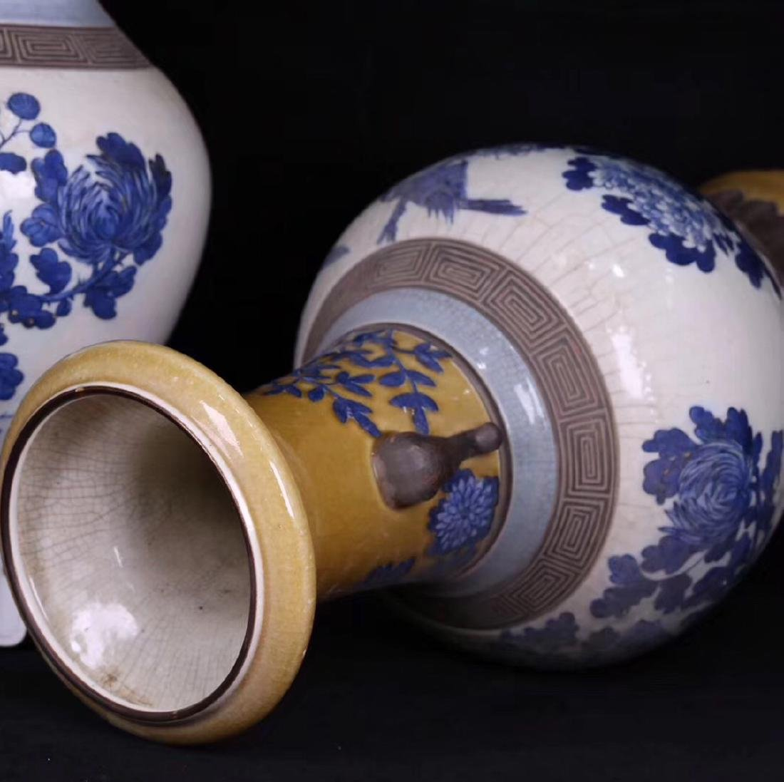 PAIR BLUE AND WHITE FLORAL PATTERN VASES - 3