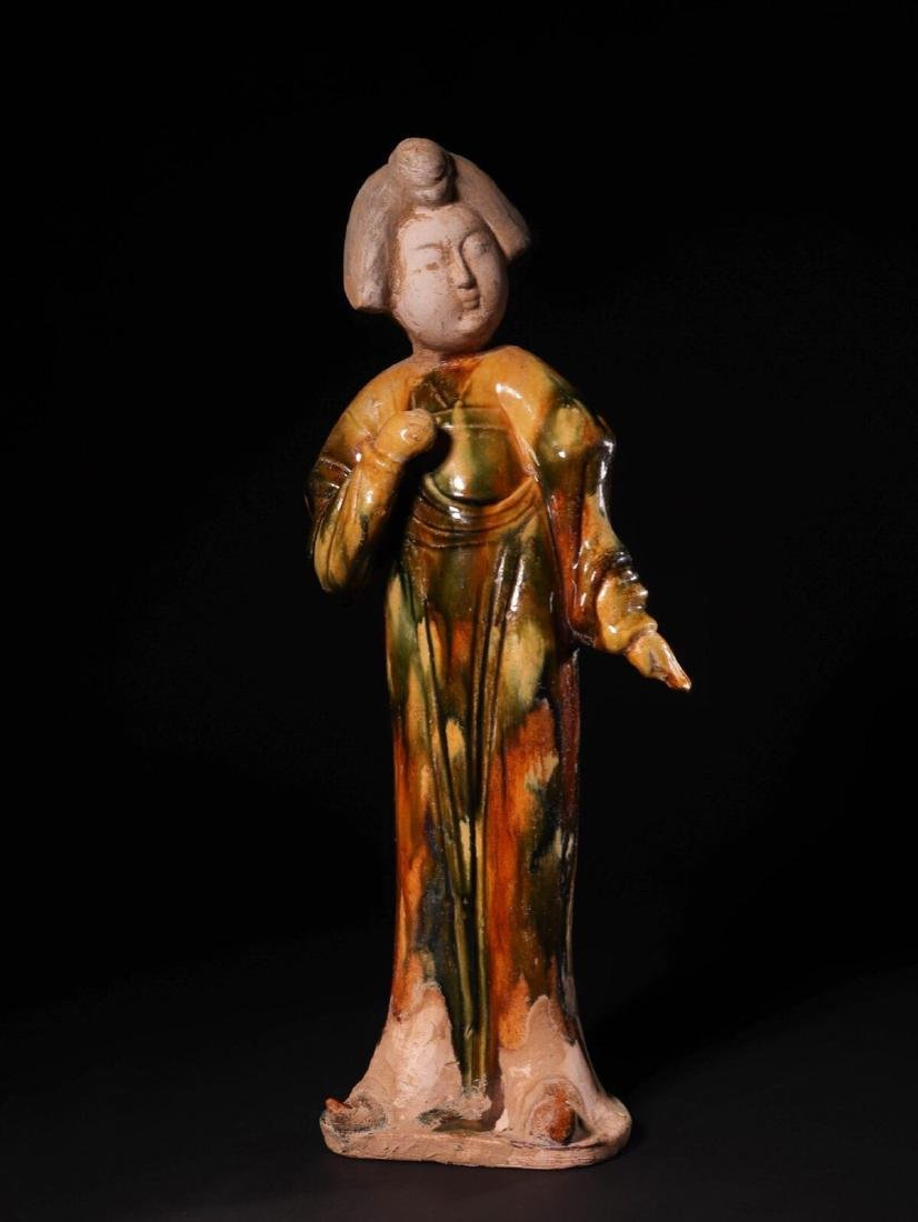 (618-907 CE) A TANG TRI-COLOR GLAZED FAT GIRL STATUE,