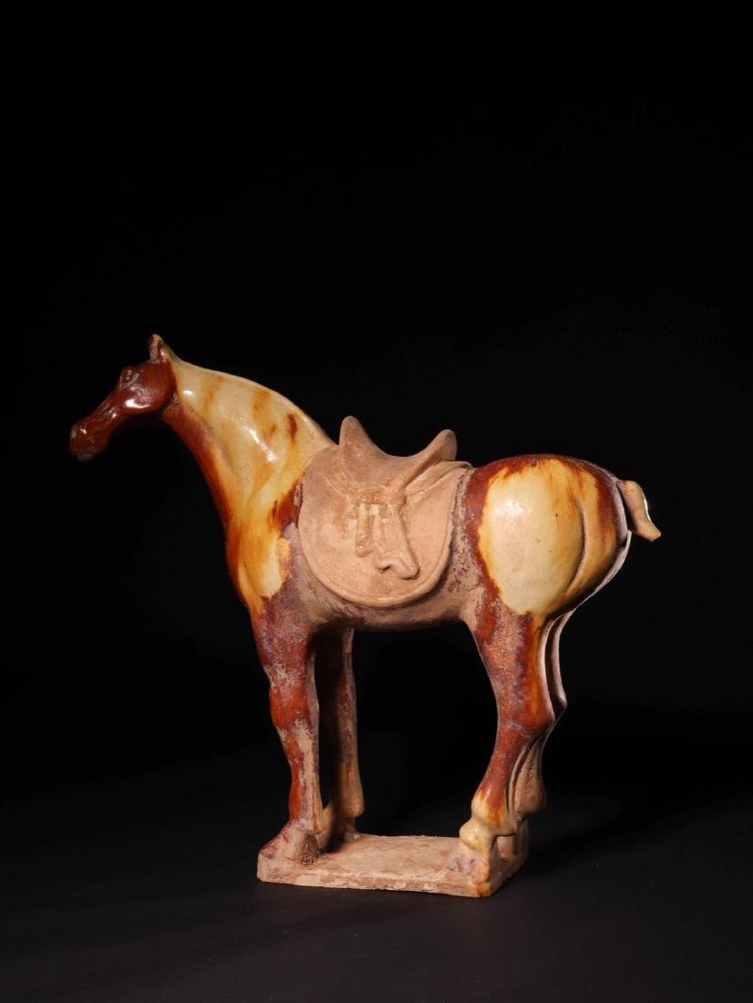 (618-907 CE) A TANG TRI-COLOR GLAZED HORSE STATUE, TANG