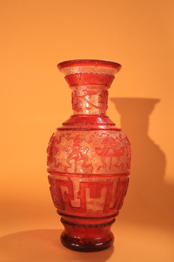 AN OLD COLOURED GLASS VASE