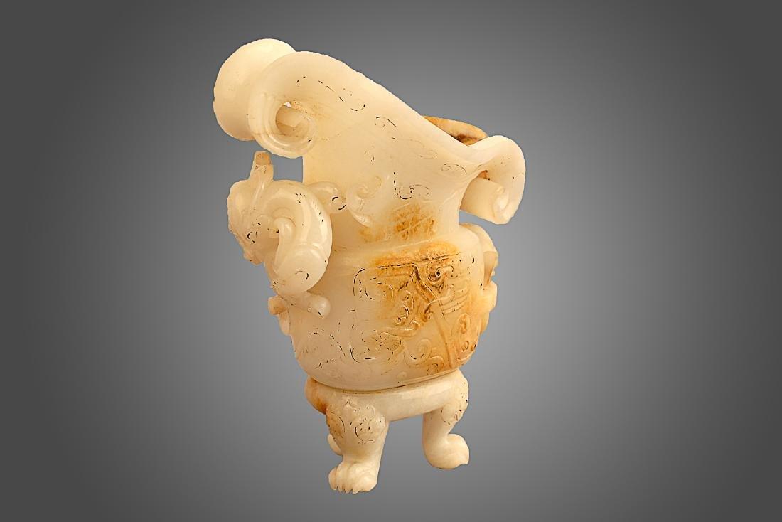 206 BC-220 AD, A DRAGON PATTERN TRIPOD CUP, HAN DYNASTY