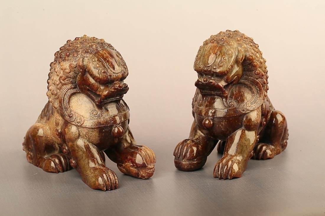A PAIR OF LION PATTERN HETIAN JADE ORNAMENTS