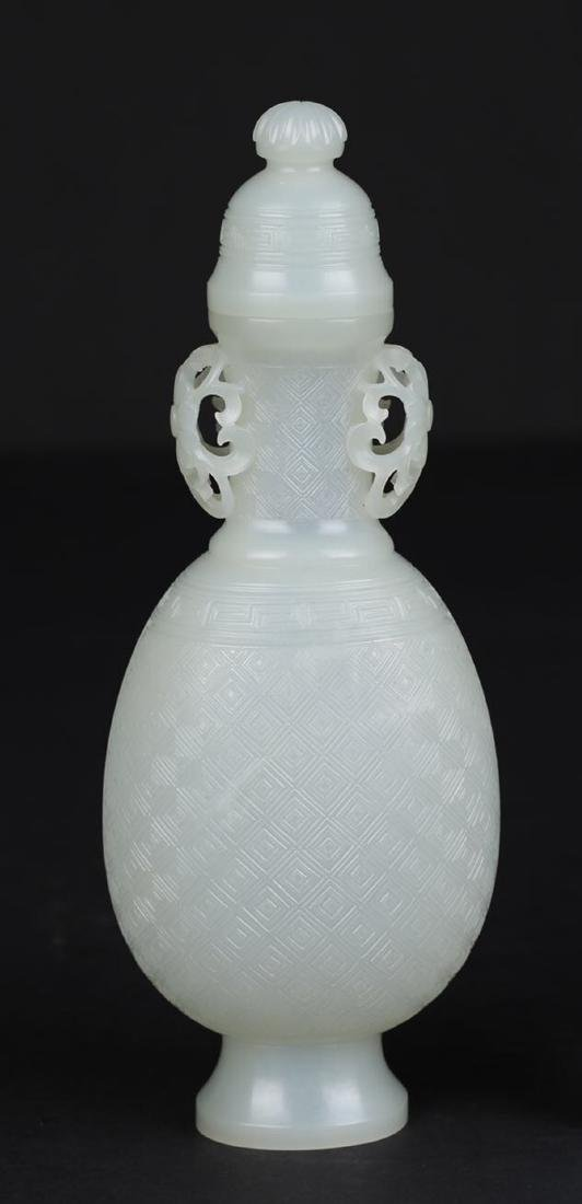 A HETIAN JADE DOUBLE-EAR BOTTLE