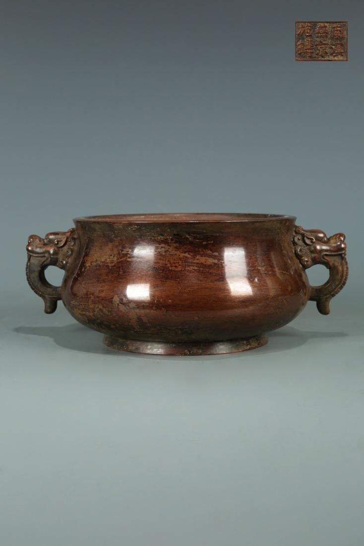 A COPPER CENSER WITH MARKING