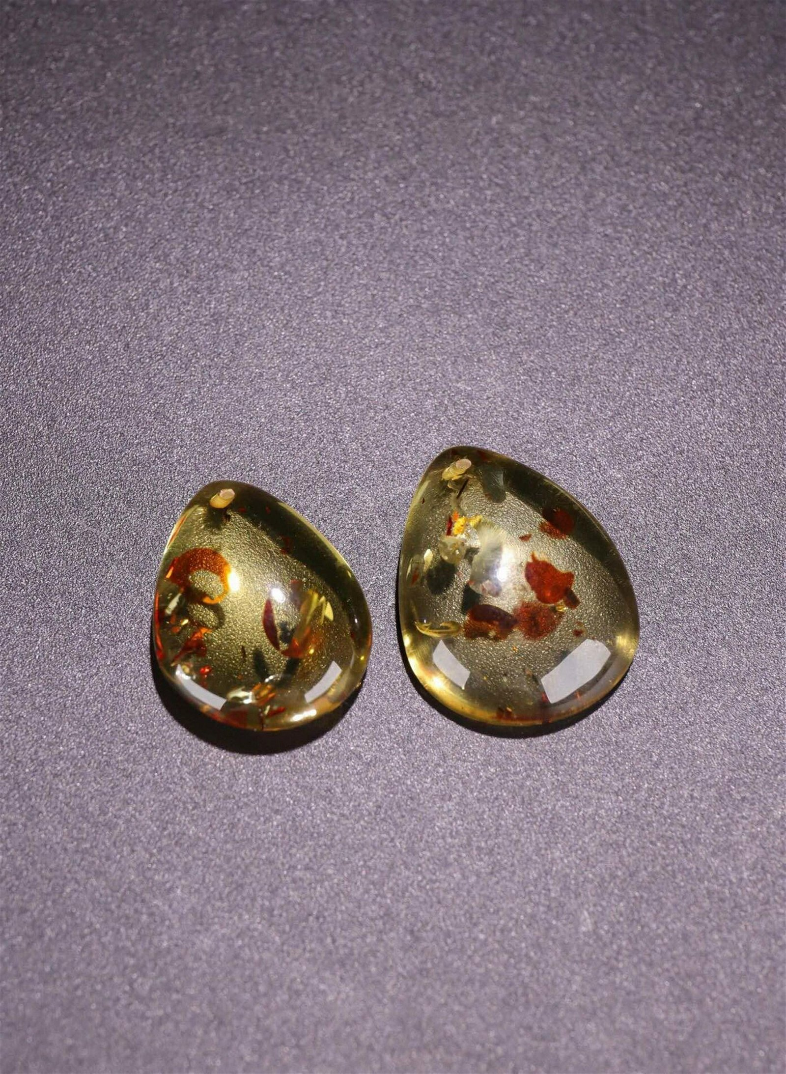 TWO AMBER PEDANT