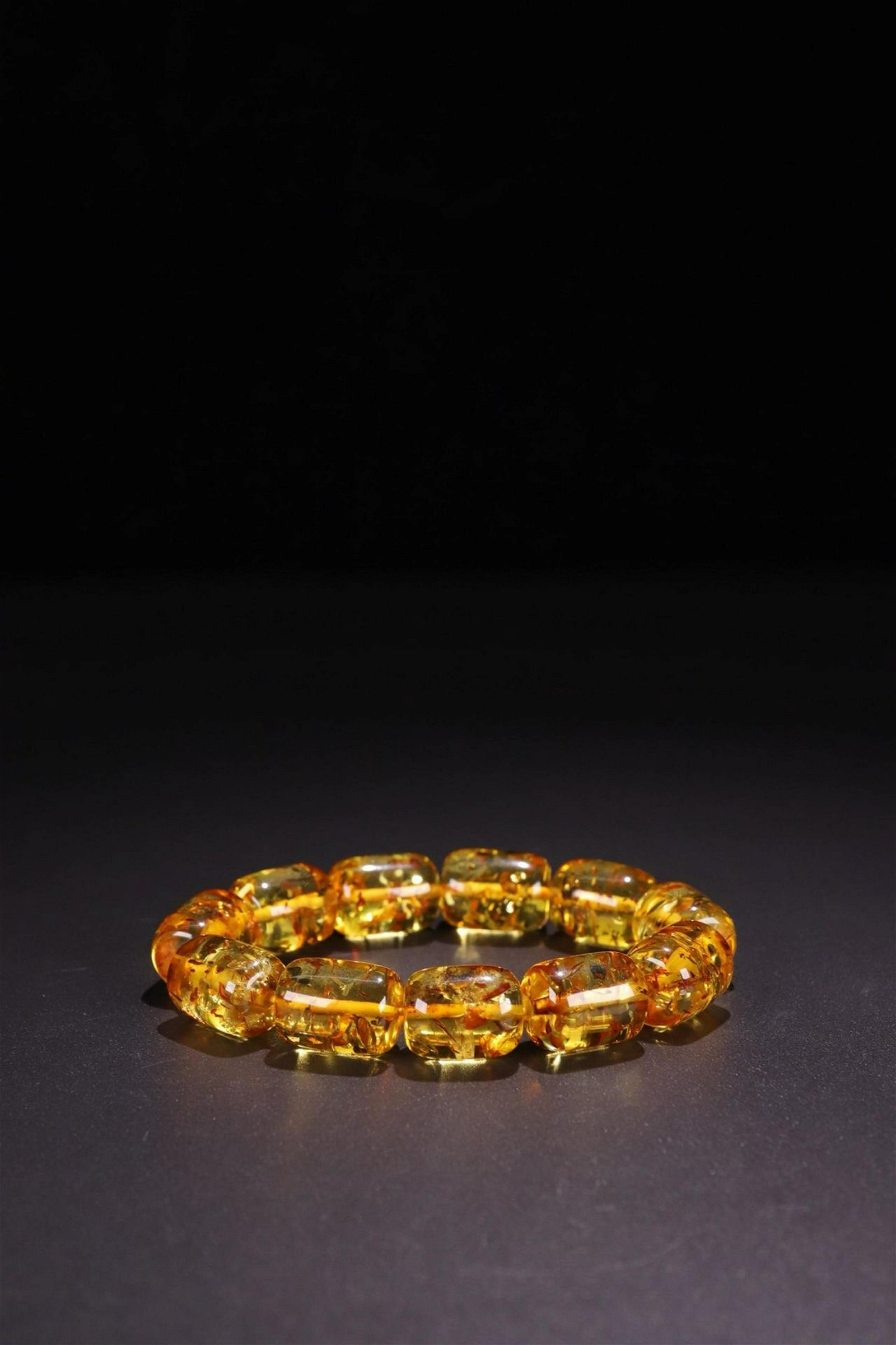 AN AMBER ROSARY