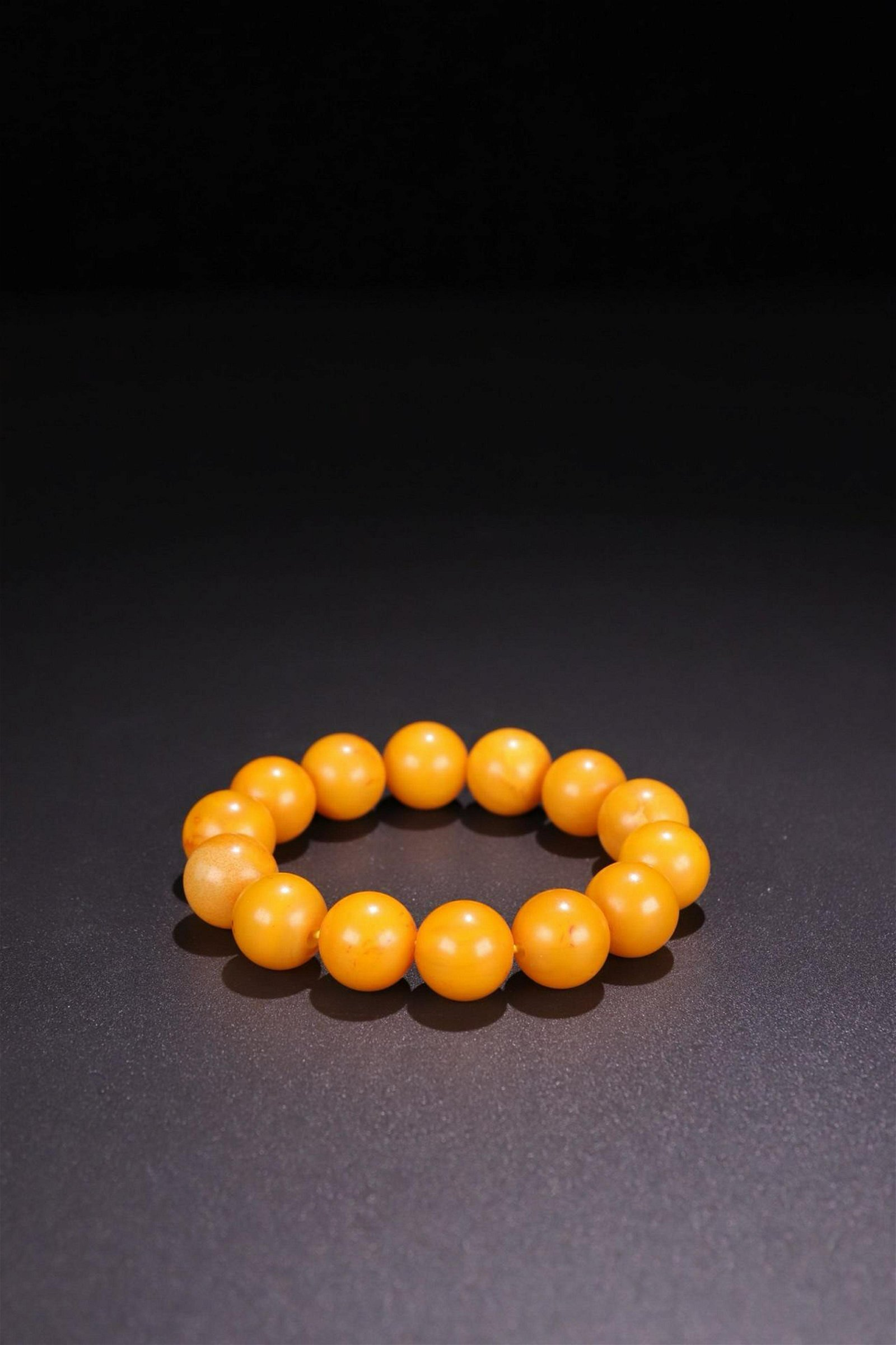 A YELLOW AMBER ROSARY