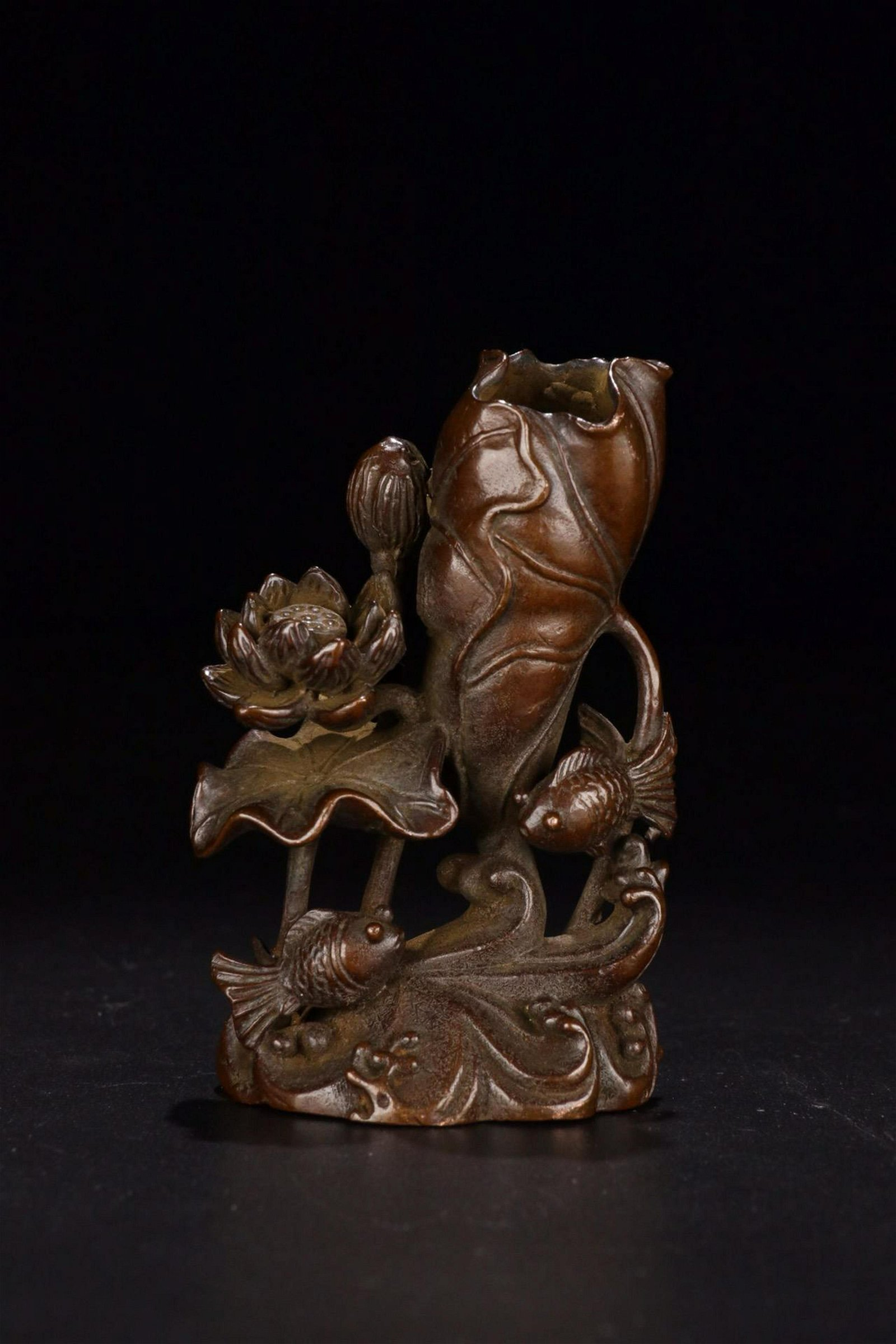 A BRONZE 'LIANNIANYOUYU' INCENSE HOLDER