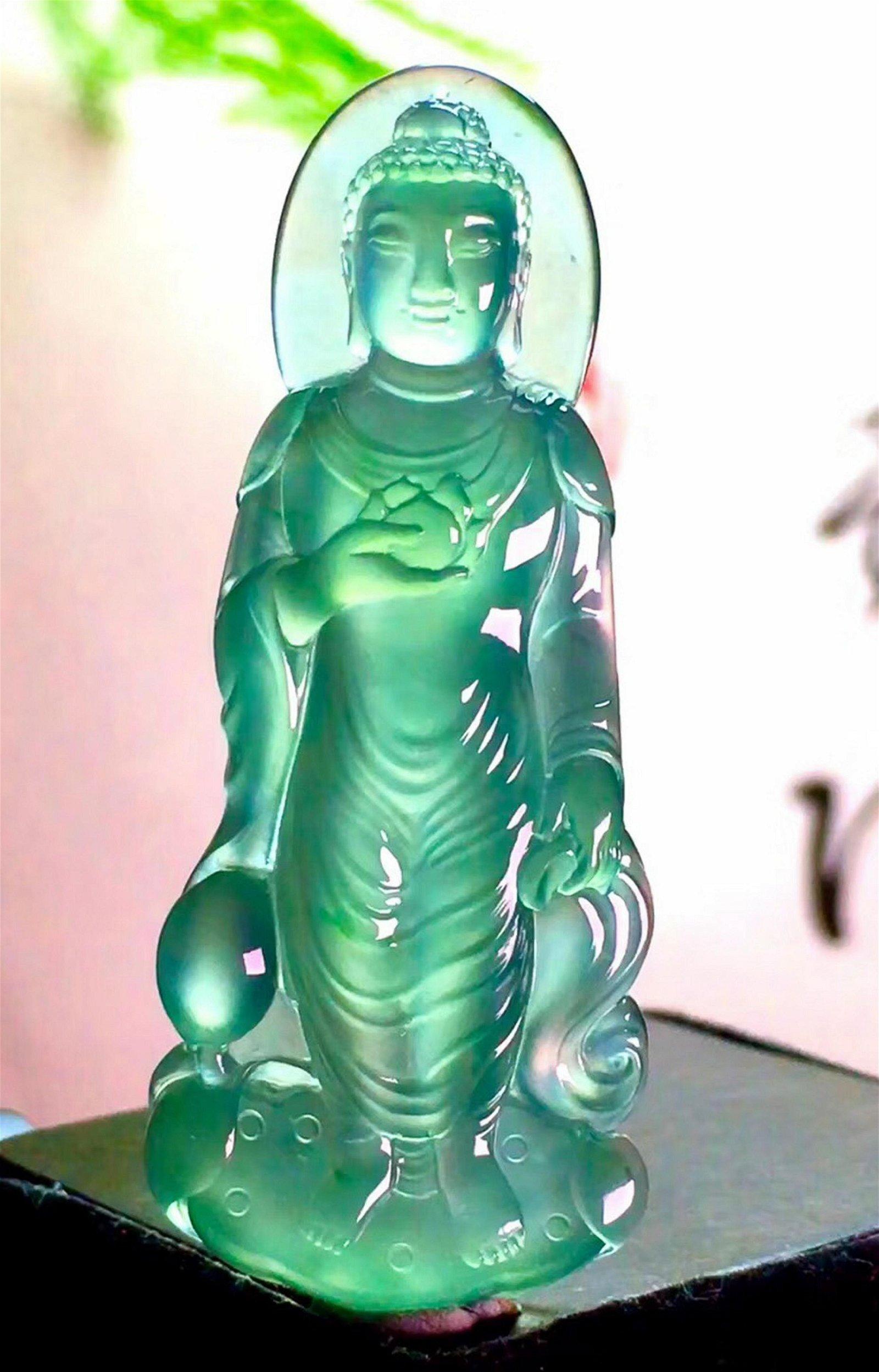 AN ICY JADEITE SHAKYAMUNI BUDDHA SHAPED PENDANT