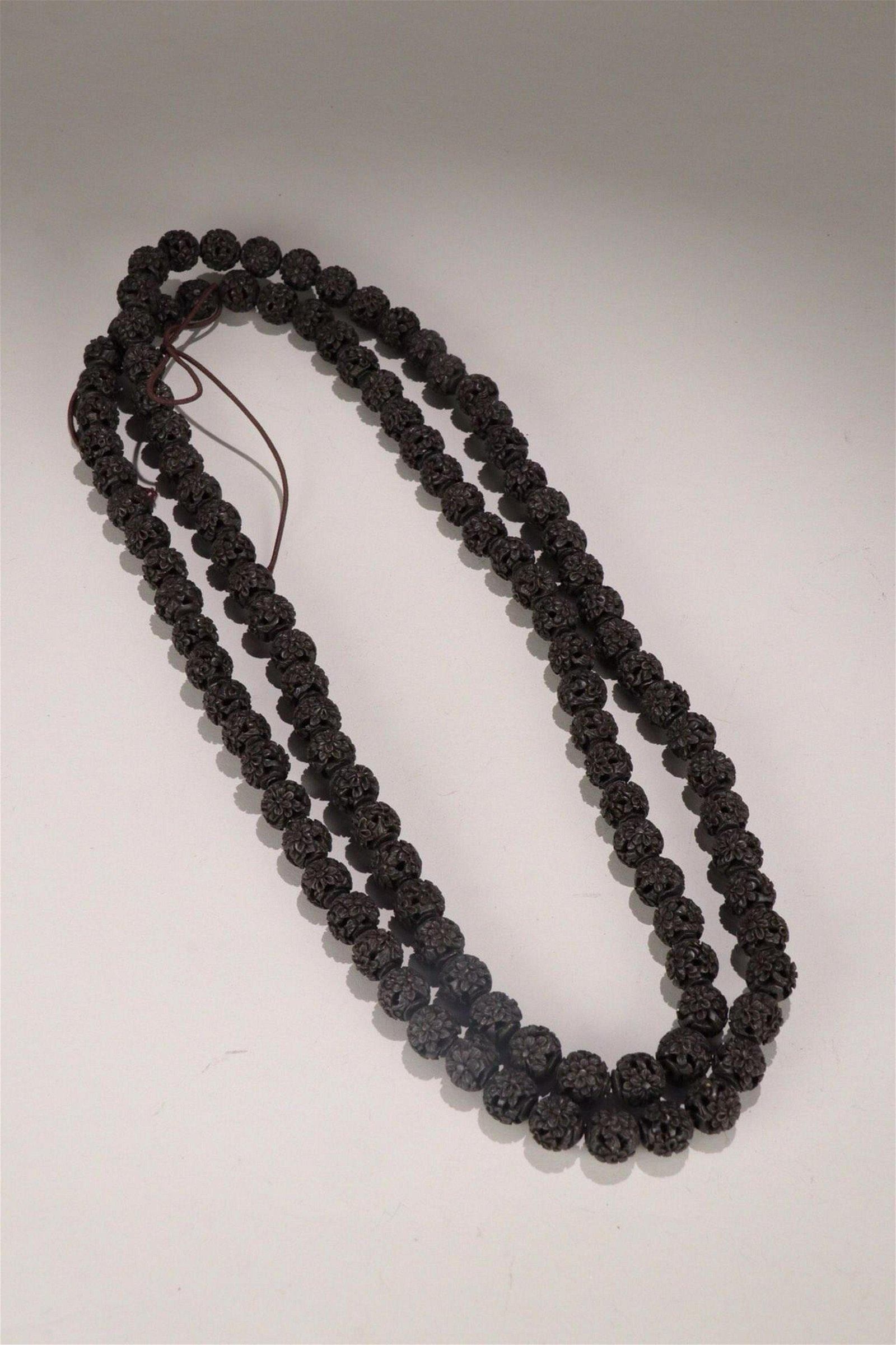 A CHENXIANG WOOD  ONE HUNDRED EIGHT CARVED FLOWER BEADS