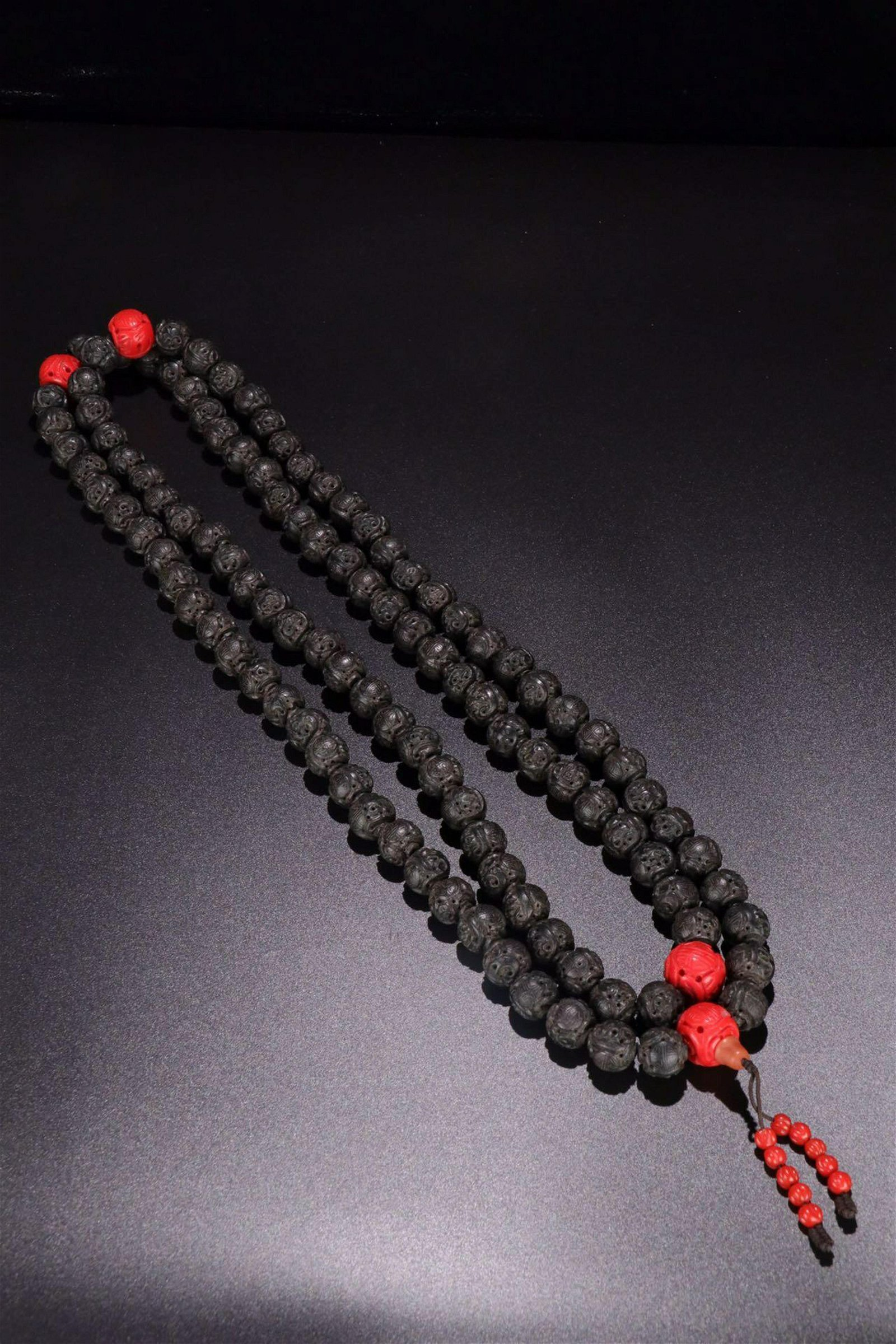 A CHENXIANG WOOD CARVED 'SHOU'PATTERN ONE HUNDRED BEADS
